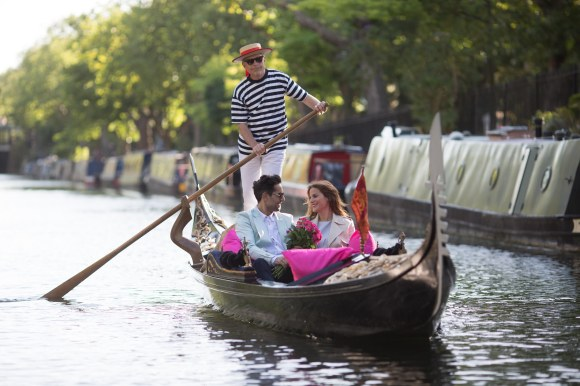 EDITORIAL USE ONLY Ilari Ridolfi from Perugia flirts with Davide Infantino from Sicily to launch the lastminute.com School of Flirting, onboard a Gondola in London's Little Venice. PRESS ASSOCIATION Photo. Picture date: Tuesday August 4, 2015. Research by  lastminute.com has revealed that British women would most like to have a holiday romance with an Italian man. The flirting classes, which will take place at the Blue Bridge over the canal on Westbourne Terrace Road in London's Little Venice from 11am-2pm, Friday August 7th, will be a mix of role-play and essential top tips, giving participants the chance to build their confidence and learn the art of flirting. Photo credit should read: David Parry/PA Wire